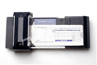 old-credit-card-swiper-ist2-675825-credit-card-swipe-device.jpg